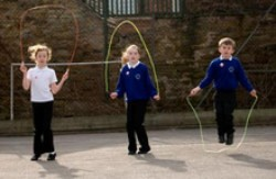 Primary school children skipping